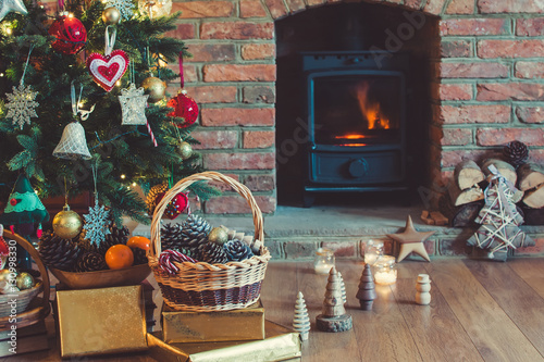 Christmas Decorations In The Basket In Front Of The Fireplace With