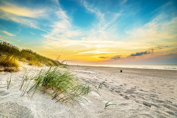 FototapetaSand dunes against the sunset light on the beach in northern Poland