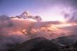 Ama Dablam peak (6856 m) above the clouds at sunset. Nepal, Himalayas.