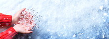 Winter Concept - Young Hands Holding Snowflake