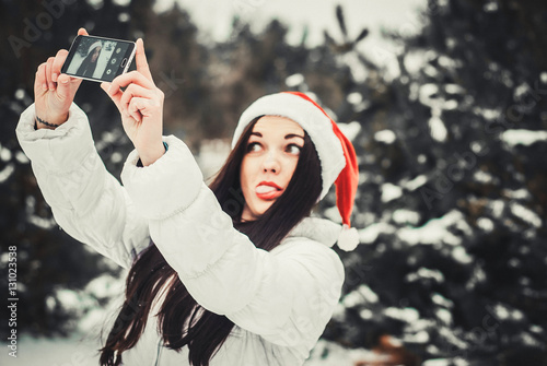 845c57ac4af4a funny girl taking selfie. Christmas girl outdoor self portrait. Woman in  winter clothes and