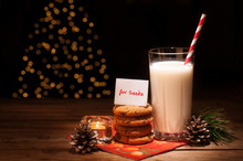 Christmas Cookies Milk Note For Santa In Front Of Lights New Year Tree
