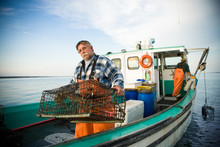 55  Year Old Fisherman On Boat With A Lobster Trap.