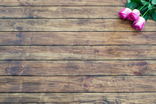 Roses On A Wooden Background