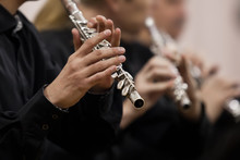 Hands Musician Playing The Flute In The Orchestra Closeup