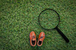 toy leather shoe on grass field texture background with copy-spa