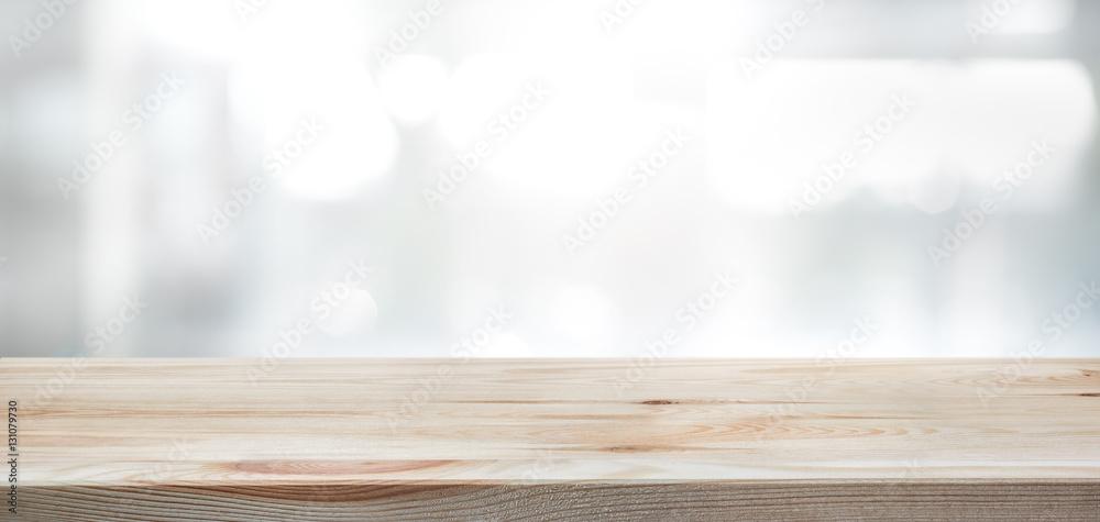 Fototapeta .Wood table top on blur glass window wall building background.