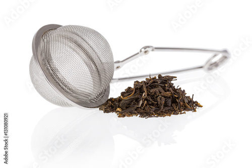 Fotografia, Obraz Tea infuser with Green Tea leaves isolated on a white background