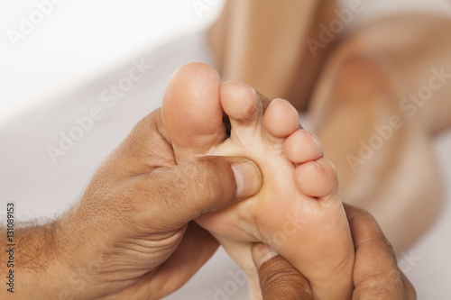 Photo reflexology and acupressure on women's feet