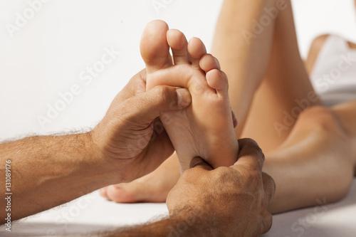 Photo reflexology and acupressure on women's feet