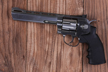 Revolver Gun On A Wooden Table