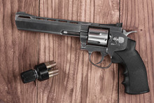 Revolver Gun And Bullets On Th...