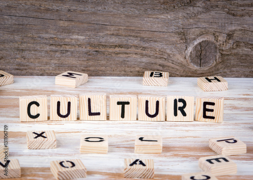 Fotografiet  Culture from wooden letters on wooden background
