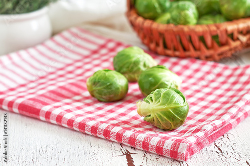Papiers peints Bruxelles Fresh raw brussel sprouts on white rustic wooden background