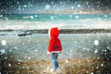 Santa Boy At Sand Beach Water