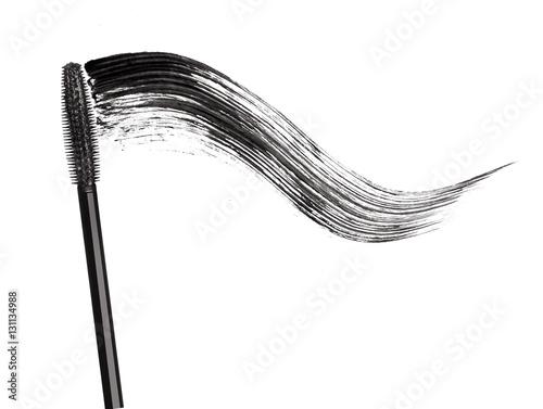 Valokuva  Stroke of black mascara with applicator brush close-up, isolated