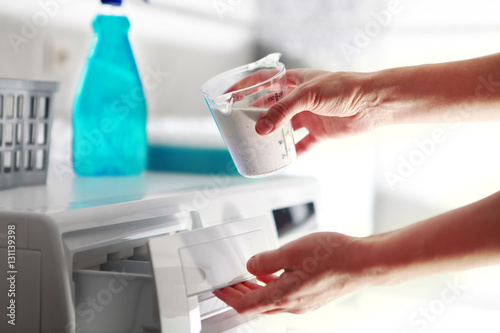 hands of woman that fills detergent