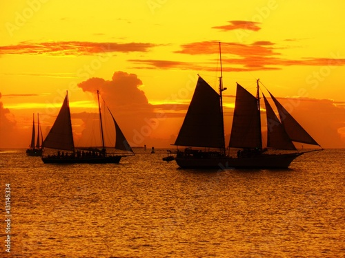 Fotobehang Baksteen Sunset and boats in Key West
