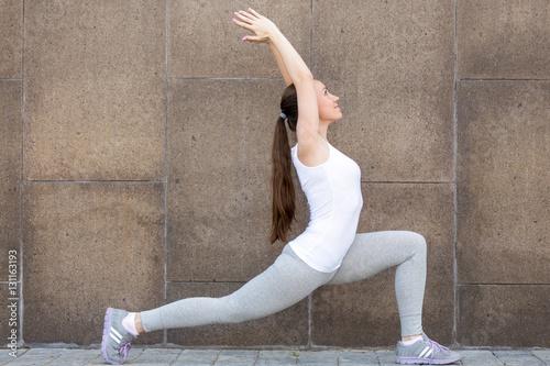 Fotografia, Obraz  Sporty attractive girl practicing yoga, standing in Horse rider exercise, anjane