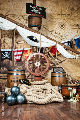 Fotografie, Obraz  Pirates ship deck with steering wheel and flag