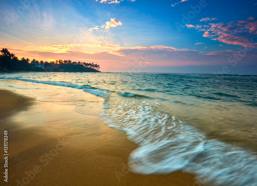 Foto auf Gartenposter Strand Sunset view of tropical beach in Mirissa, Sri lanka