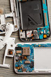 Disassembled parts of cell phone on wooden table