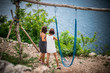 Vacation concept. Young women swing on a beach swing on the cliff. Selective focus. Tropical island Nusa Lembongan, Indonesia. The ocean on a background.