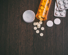 Top View Of Medicine Pills And Tablets With Orange Pill Bottle For Healthcare.