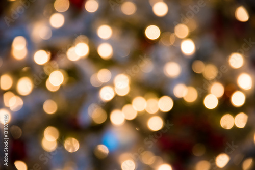 festive new year background with bokeh from christmas tree lights glowing blurred colorful circles
