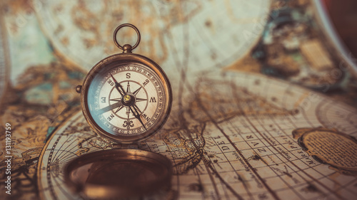 Fotografie, Obraz  Antique compass and old world map.