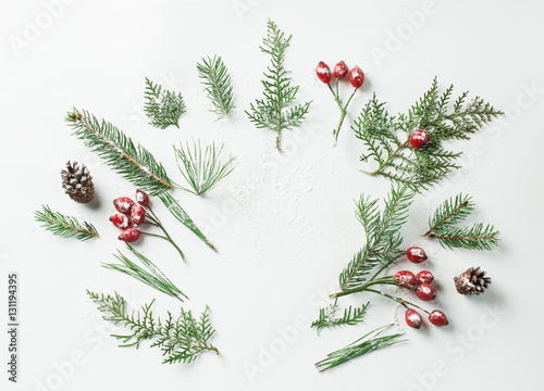 Stickers pour porte Spa Creative mockup layout made of christmas tree and red snowy holly berries branches with copy space on white. Homemade flat lay concept