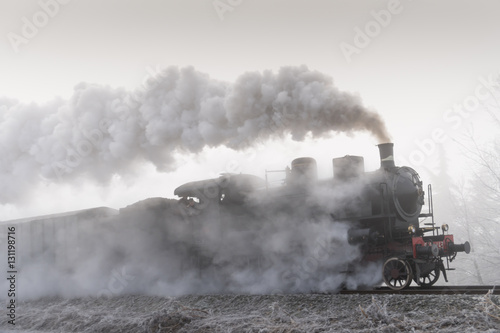 Fototapeta Steam train running in the fog obraz na płótnie