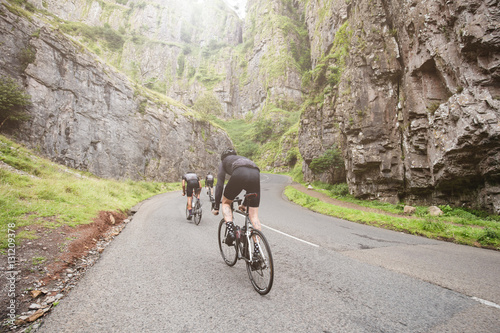 Three cylists attacking the climb in Cheddar Gorge, U.K