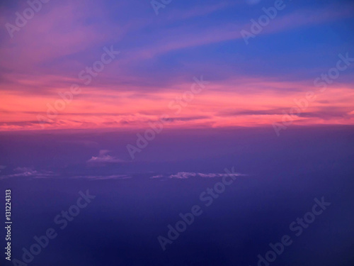 ariel view of clouds and sky in sunset above city Canvas Print