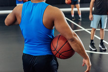 Male Basketball Team And Trainer On Basketball Court