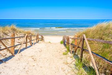 Entrance to sandy beach on coast of Baltic Sea near Lubiatowo village, Poland