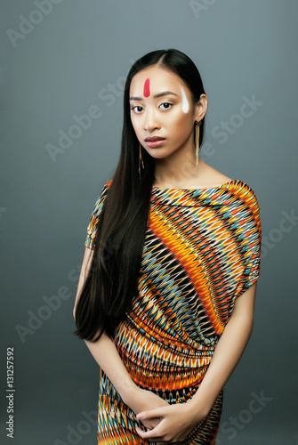 beauty young asian girl with make up like Pocahontas, red indian Poster
