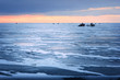 Dawn on the frozen Baltic Sea Biosphere polygon. Ice fishing for