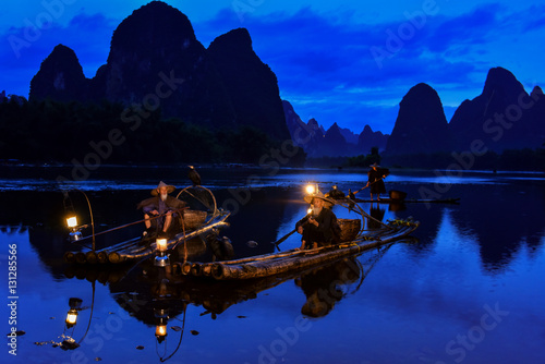 Fotobehang Donkerblauw Fisherman of Guilin, Li River and Karst mountains during the blue hour of dawn,Guangxi China