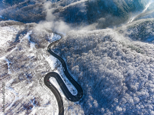 Winding road in the middle of the winter in a high mountain pass