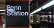 NEW YORK - Circa December, 2016 - The Penn Station subway ID sign as a train approaches.