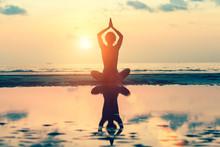 Sunset Yoga Woman On Sea Coast..