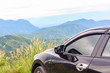 Closeup car over the mountain background, travel concept with copy space