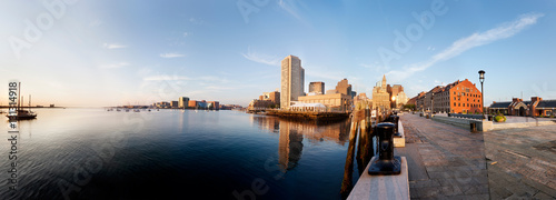 Obraz Morning sun lights up Boston Harbor and the downtown waterfront. Taken from the end of Long Wharf - fototapety do salonu