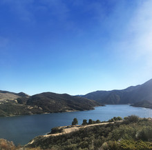 Pyramid Lake With Hills On A Blue Sky