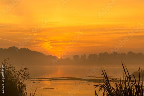 Fototapety, obrazy: Orange sunrise above the lake