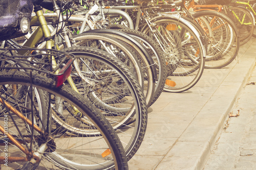 Photo  Group of colorful vintage bicycles parked on a row in Born, Barcelona, Spain