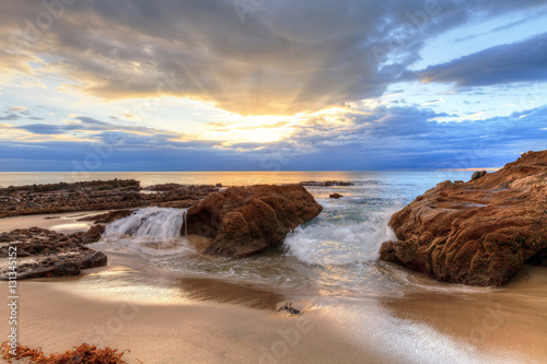 Foto auf Acrylglas Bestsellers Sunset over the rocks at Pearl Street Beach in Laguna Beach, California, USA