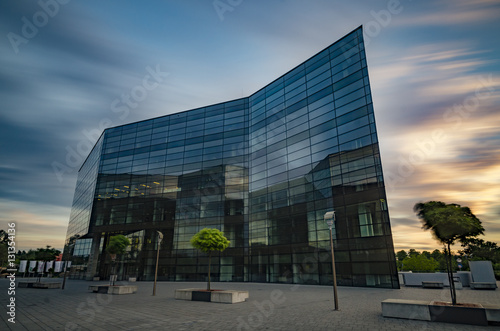 Fototapety, obrazy: Office building with glass facade,Modern office building in the evening