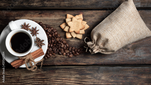 Spoed Foto op Canvas Cafe Coffee composition with black coffee, cinnamon and cookies on the old wooden table